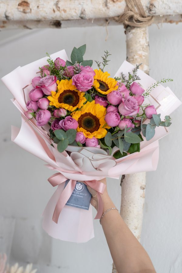 Sunflowers with pink rose spray